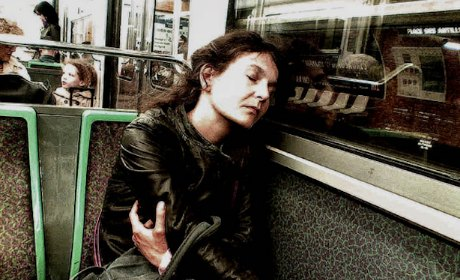 Chris Marker, image of woman asleep on métro in Paris, published in Passengers by Peter Blum Gallery